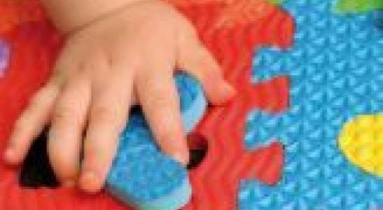 baby hand on playmat